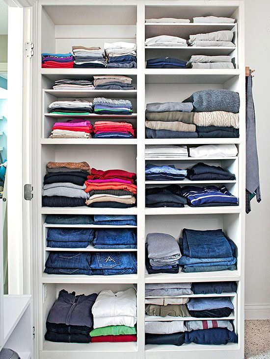 Different heights of shelves offer more flexibility in a master bedroom closet. If you don't want to fuss with built-in shelves, try dividers that slip into larger spaces -- used here to keep track of thinner T-shirts and other items.
