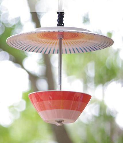 Bird feeder made from colorful dishes. Great idea!!