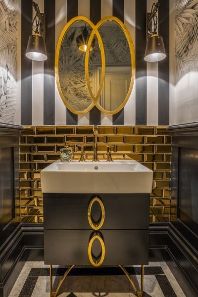 Gold subway tiles in a quirky bathroom