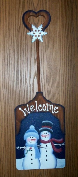 A wooden shovel that I painted with acrylics. Christmas gift for my friends Jen & Frank :)