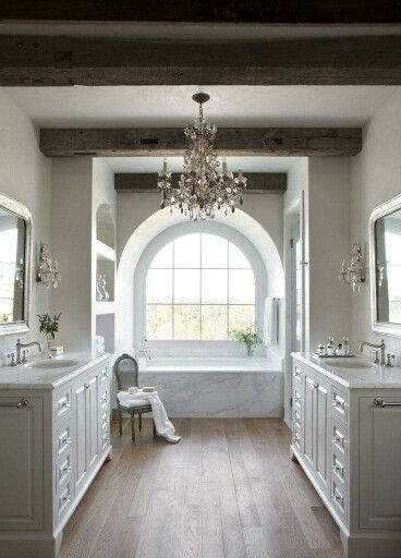 Love the built in shelves, the wood beams and chandelier