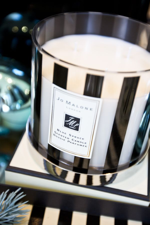 Jo Malone London | Blue Spruce Deluxe Candle   This candle adds a high-end, luxurious feel and fills the spaces in the office both visually and aromatically. There is also a positive high-end market association created between the world renowned Jo Malone brand and Victoria's agency.