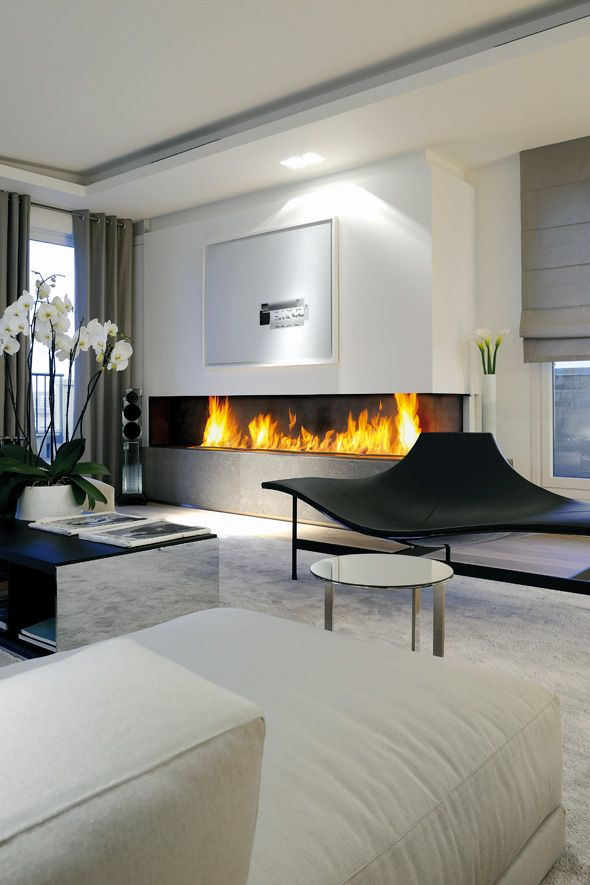 linear fireplace and sculpted chair.