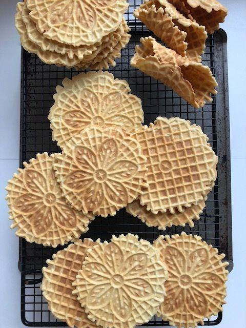 Pizzelles are an Italian thin waffle style cookie that is made from flour, eggs, butter, anise and vanilla. They are a tradition in Italian homes and usually made for special occasions and holidays. I grew up eating pizzelles that my grandmother made at every family get together and the very tradi