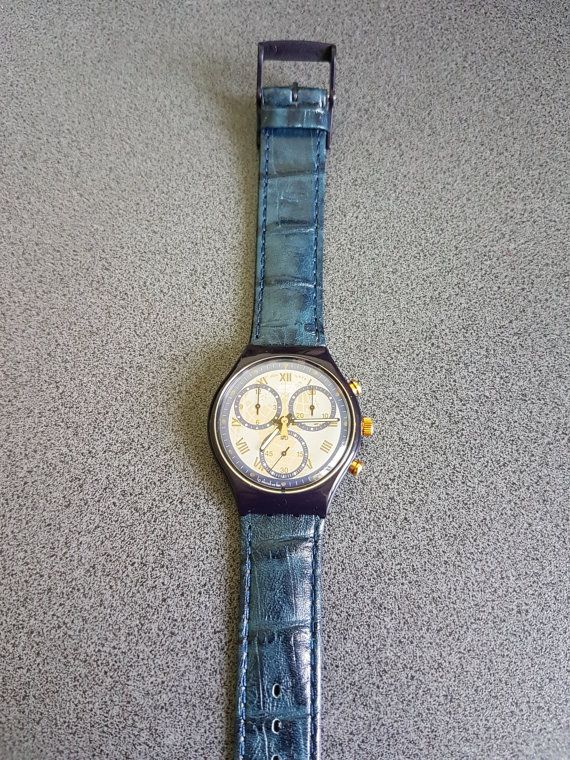 Condition: 99% New, Never Worn!  Genuine Swatch   Swatch Watch  Timeless Zone  1992  SCN104  Leather band.    100 ft deep water resistant. Shock resistant.  This is New old stock. It has been in a drawer since 1992. You will need a new battery. About $5 if the jeweler changes it.  Clean, no smoking, no pet home.  Down sizing empty nester.  thanks for looking.      All watches exposed are part of a big collection. For more watches and custom listings, please message me.   !!!**** BEST DEALS…