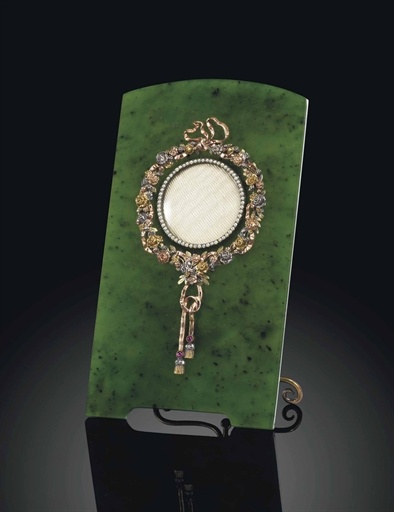 A jewelled silver-gilt and four-colour gold-mounted nephrite photograph frame marked Faberge