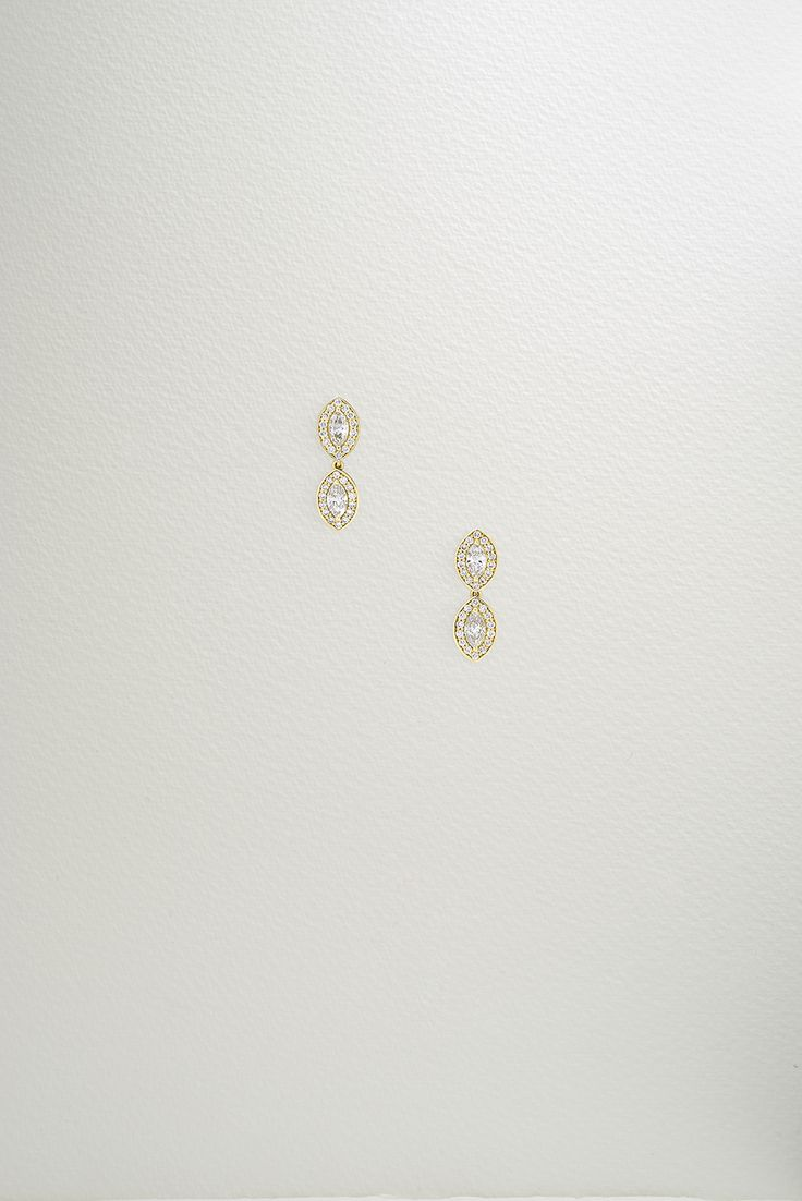 Photographer: Leo Bieber, featuring the Empress Drop Earrings. The Empress Drop Earrings are a delicate translation of the fiery Empress Earrings. By suspending two glittering laboratory created marquise cut diamonds (1 tct), encircling each with 0.28 tct pavé-set diamonds and setting in 18k Fairtrade gold, they are the perfect finishing touch to any occasion.