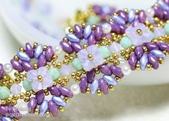INCREDIBLY BEAUTIFUL, I ADORE THIS EXQUISITE BRACELET WHICH I FEEL, WOULDN'T BE TOO DIFFICULT TO MAKE!! (One could easily swap out the colours, if desired!)