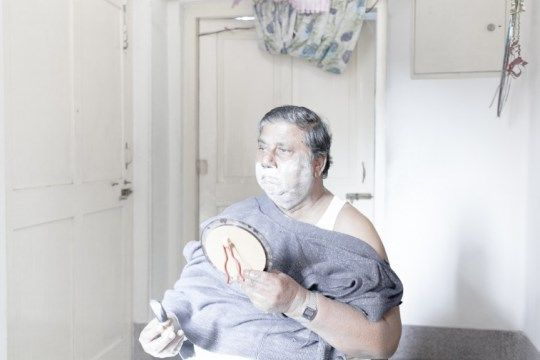Sarker Protick's ethereal photographs from 'What Remains' shows the last few years of his grandparents, John and Prova, in Bangladesh. The images show a transition between the young and old, life and death. John moved to Dhaka with his wife after getting retired and was diagnosed with Cancer, around the same time, his wife, Prova, got a heart-attack. Protick started visiting them often, the pictures show their declining health and their day-to-day lives in natural day light.