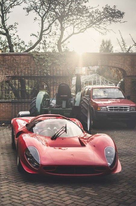 Ferrari P4. How great that a tractor Ford Ranger are featured nearly as prominently? I like the non-staged aspect.