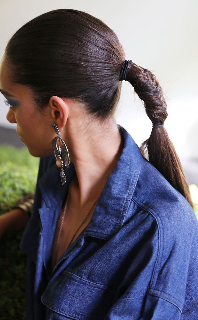 This slicked back, fishtail braid style (created by hairstylist Rodney Cutler) is the ultimate cool girl twist on a ponytail.
