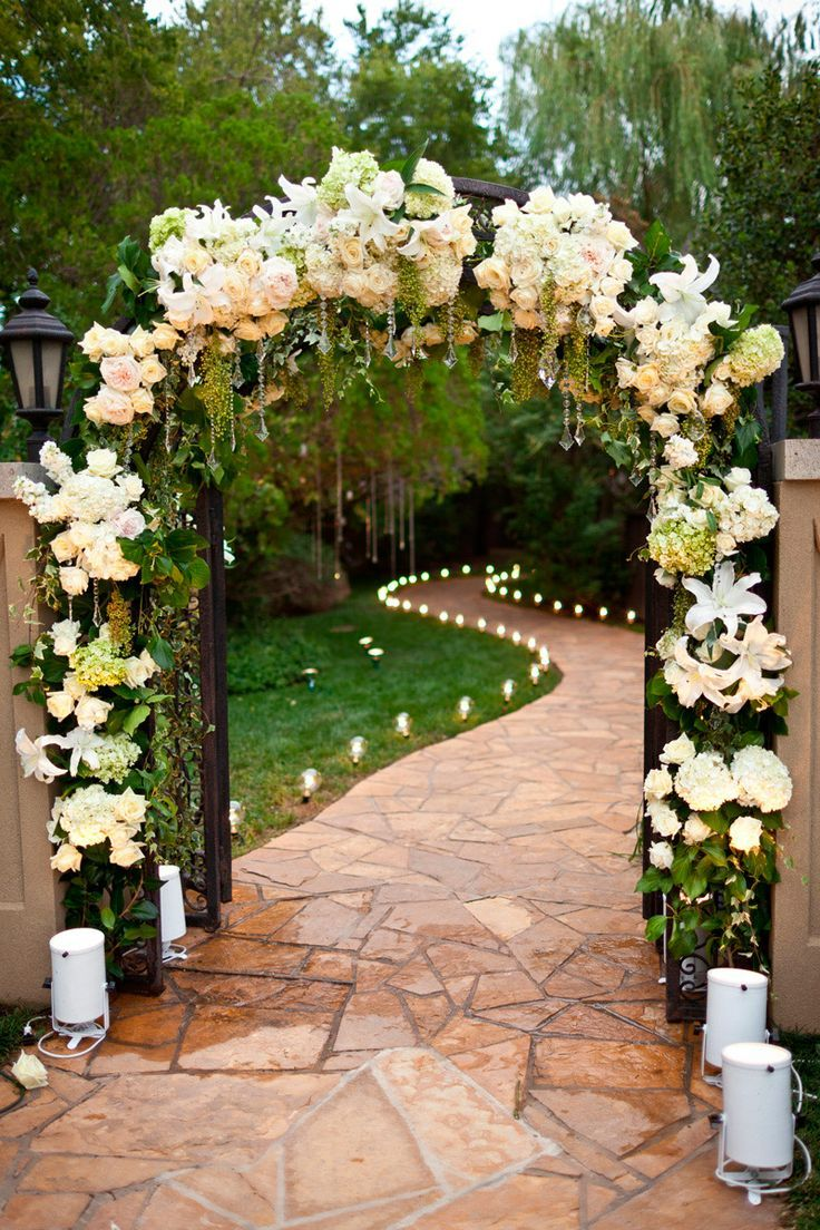 Floral arch into backyard wedding reception