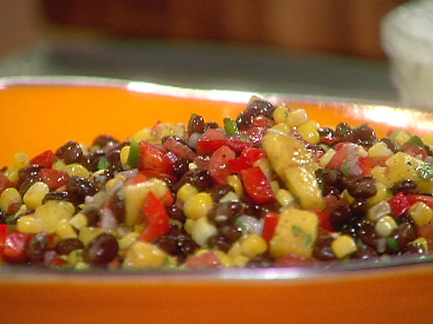 THE BEST yummy black bean salad. really good for summer or fish taco side dish.  But with NO Pineapple and only fresh corn when available. otherwise no corn. either/or on the onion.