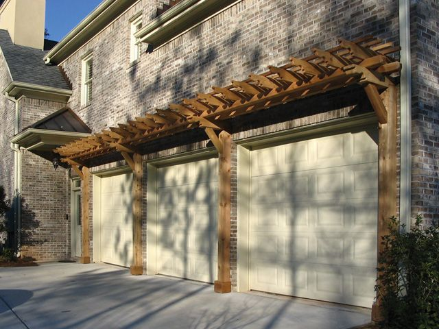 I like the posts going to the ground - Cedar Pergola over Garage Doors from  Atlanta Decking and Fence Company - 29 Best Pergolas Over Garage Images On Pinterest Garage Trellis