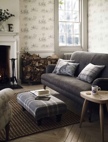 Scottish country manor living room. The grey sofa and plaid footstool are lifted by the intricate drawing on the hare cushion. Items by John Lewis.