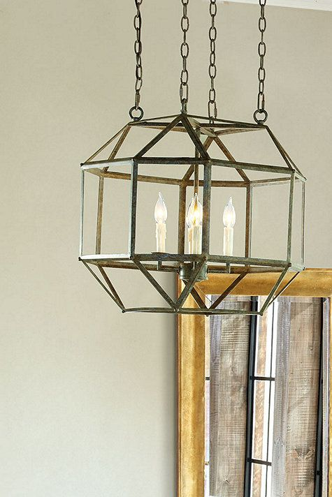 A sculptural geometric look with a light, airy feel. Our Clive 4-Light Pendant is crafted in open facets of riveted metal and hand finished in deep verdigris. Open bottom lets you see the candle cluster from beneath. Clive 4-Light Pendant features: Cream faux drip candle sleevesRivet details Metal with deep verdigris finish