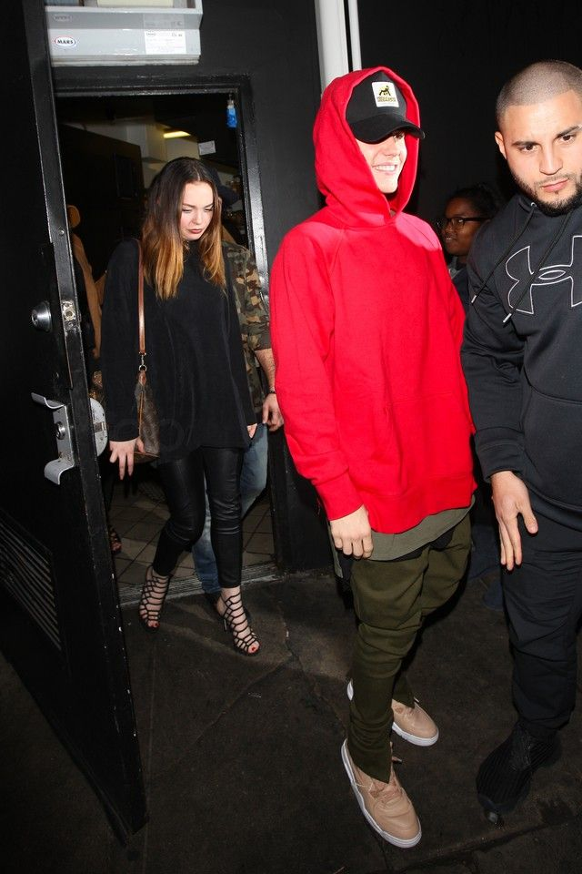 Justin Bieber wearing  New Era XXlarge Patch D-frame Trucker Cap, Fear of God The Drawstring Trousers, Fear of God Raglan Pullover Hoodie