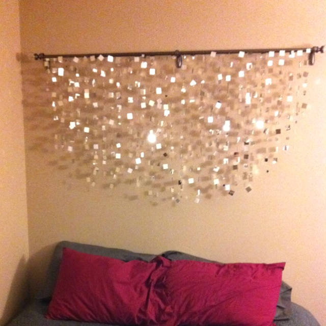 "Handmade mirror tile garland ""headboard""...forty yards of fishing line, 1000 mirror tiles, and one third degree burn (glue gun) ;)"