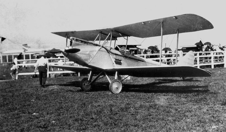 Avro Avian biplane in a field, 1920-1930.