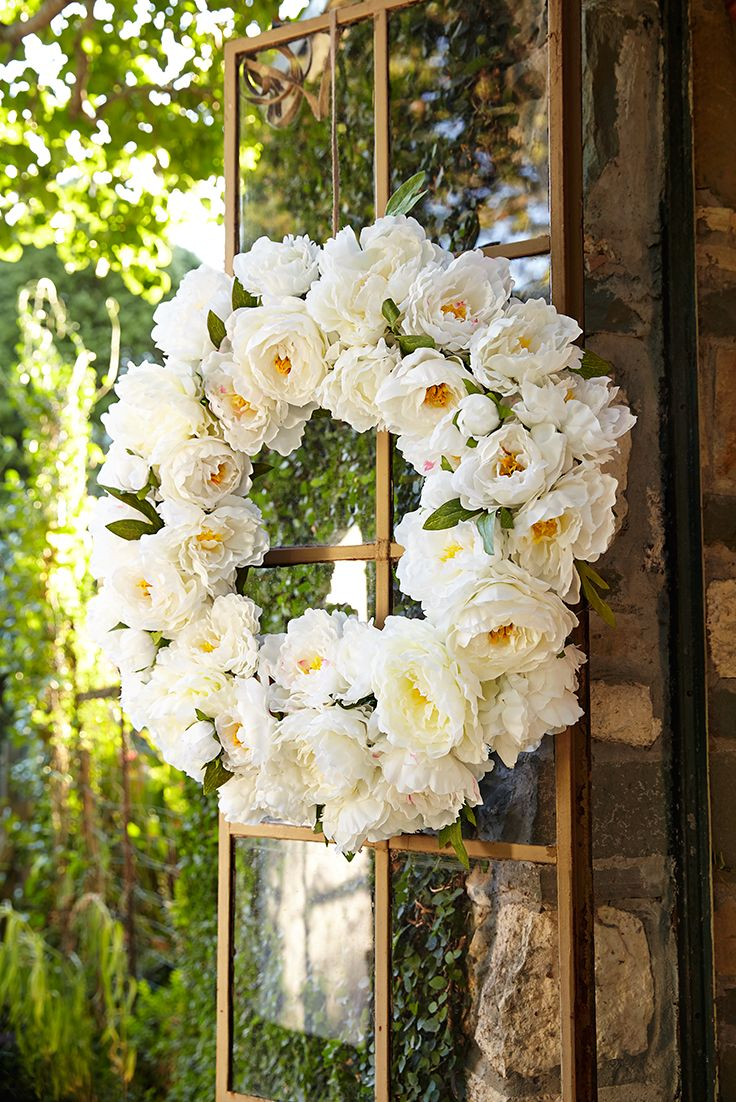 Display a warm spring welcome any time of year with Pier 1's fabulous Faux Peony Wreath. Thanks in part to the white faux peonies and in equal part to the sheer profusion of blooms, this wreath makes a major statement on your mantel, door, picture window or tabletop.