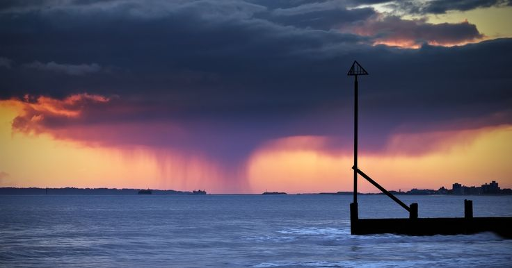 https://flic.kr/p/DPRNoN | Sunset Storm | Despite good omens for sunset today, my pal Dave and I weren't treated to any nice colours in the sky today. However, a few minutes after the sun set I spotted this interesting dark rain cloud in the distance, dumping it's contents onto the Solent between Portsmouth and the Isle of Wight.