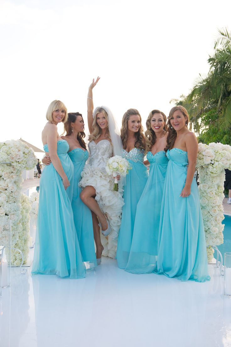 Bridesmaids in Long, Strapless Aqua Dresses | Photography: Kris Kan. Read More: http://www.insideweddings.com/weddings/joanna-krupa-and-romain-zago/515/