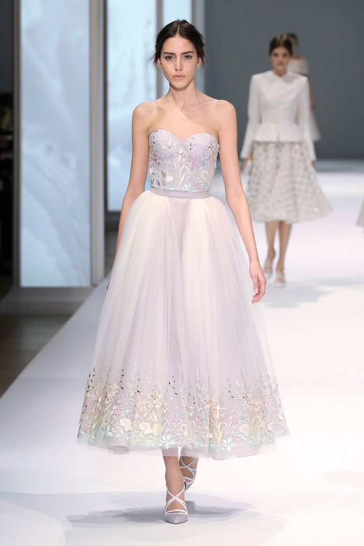 Ivory tulle with pastel and metallic thread-work embroidery and pale grey and ice blue silk organza layered bustier dress.