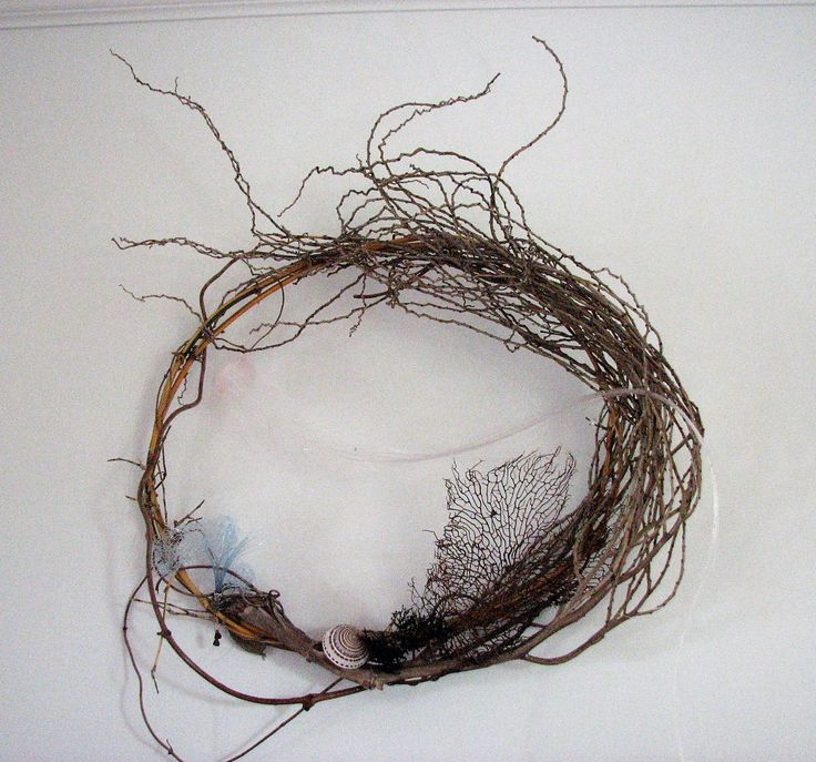 """"""" Under the Sea"""".  2D wall art made from palm inflorescence, black coral, bamboo, wonga wonga vine, sea anemone and jelly fish created from fishing line and the odd shell."""