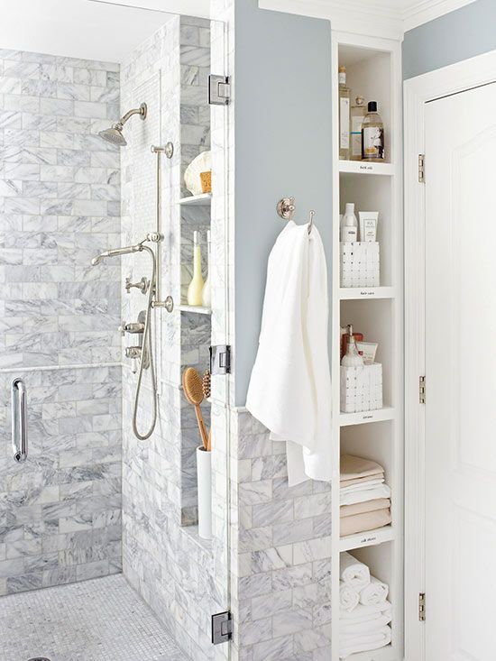 Lots of built in bathroom storage. Moving walls is a real budget buster. Instead, try utilizing found space. For example, recess shelves into the area between wall studs to create vertical storage that doesn't eat up floor space.