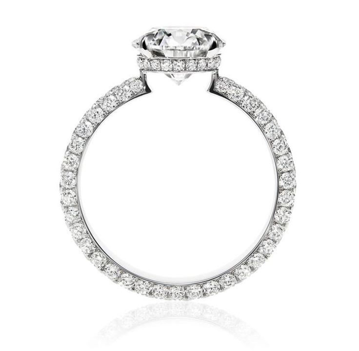 Attraction by Harry Winston, Diamond Ring. Round brilliant diamond, 2.01 carats; 124 round brilliant diamonds, 1.30 total carats; platinum setting.