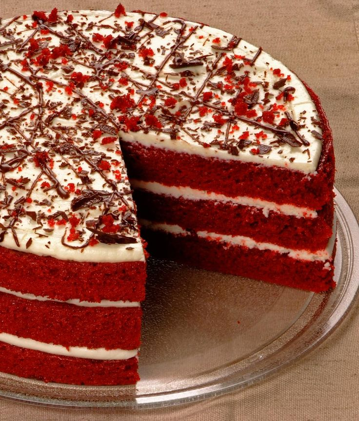 Red Velvet Cake: 1 x 24cm Three moist layers of legendary deep red velvet cake, filled with delicious cream cheese icing and topped with fine chocolate shavings, red velvet crumbs and chocolate drizzle.