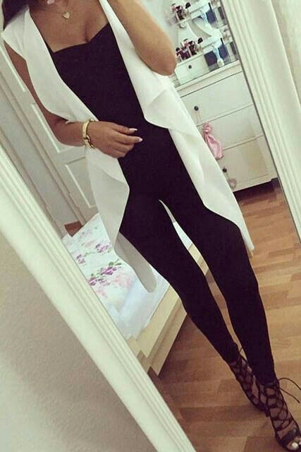 Black top & black skinnies with cream sleeveless coat very elegant