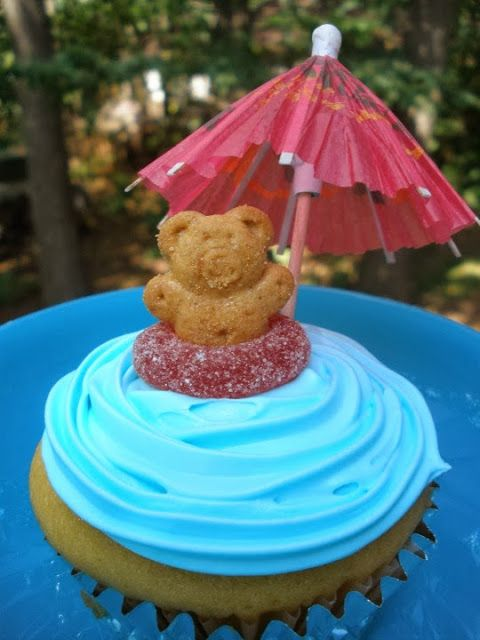 Me and My Pink Mixer: Pool Party Cupcakes - cute with gum drop circles for floats and teddy grahams thru them!