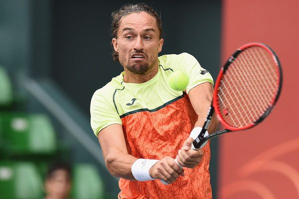 Alexandr Dolgopolov of Ukraine plays a backhand against Daniil Medvedev of Russia during day three of the Rakuten Open at Ariake Coliseum on October 4, 2017 in Tokyo, Japan.