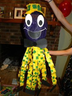 Henry the octopus pinata. Instead of whacking him, pull the legs with one opening the pinata.