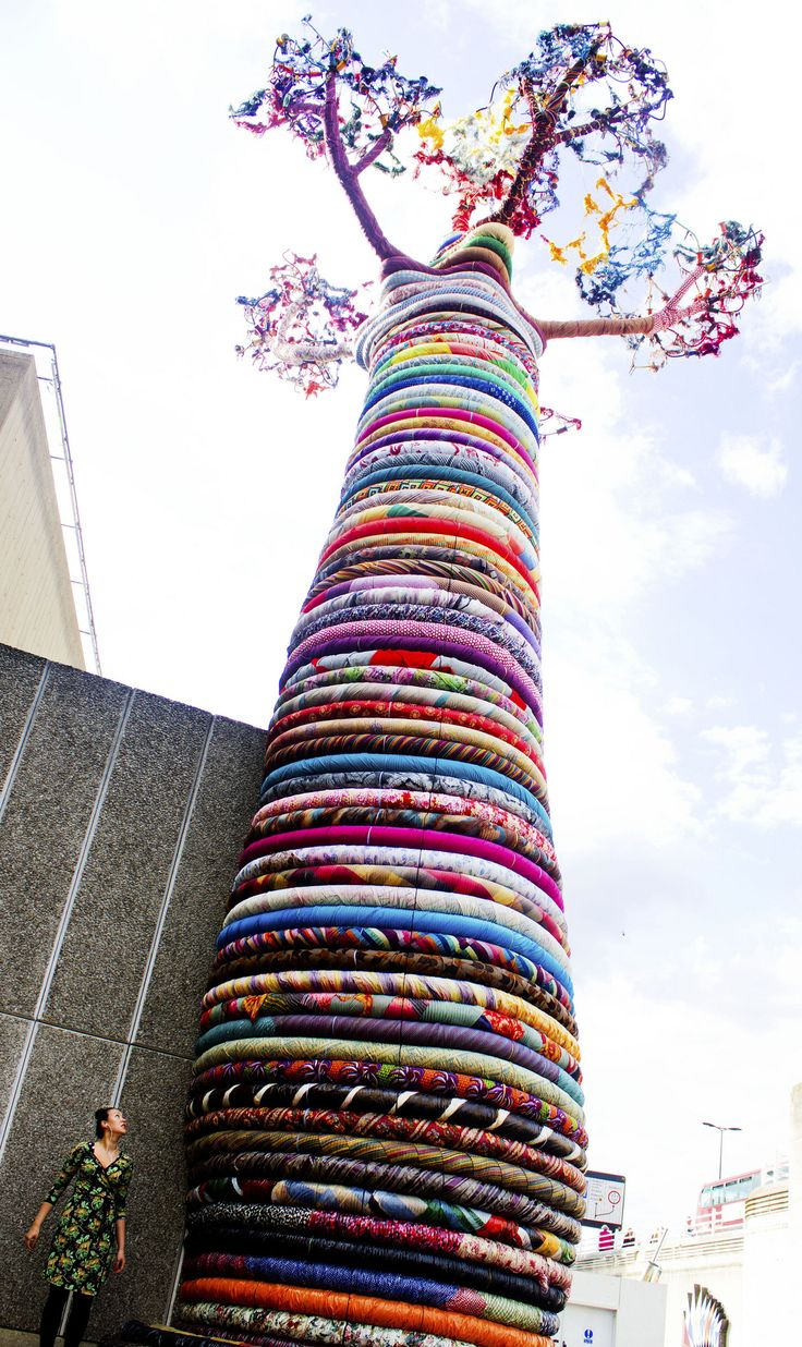 June 10 full length by GungFace  ...an enormous 15 metre tall baobab tree sculpture in Southbank, as part of the Festival of the World exhibition. Each ring is made by people and material from around the globe. I read up a little on its history - the baobab tree is the oldest living specimen in Africa, a symbol for meditation and community. View more artist at https://www.pinterest.com/covetedition/artists/. #Artists, Tree, #Colors, Covet, #Community.