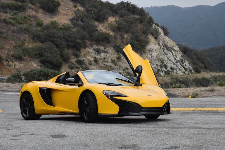 Recently, I lived out a boyhood fantasy. I got the chance to drive a supercar around town for a few days. It was bright yellow, had gullwing doors, cost twice the price of a small house, and sounded like a fighter jet taking off. It was the absurdly outlandish McLaren 650S. While some might characterize McLaren