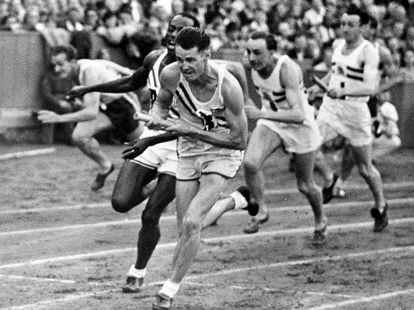 Moments in Olympics History Photos | 1948 London Olympic Relay  Photograph by the Associated Press    In the wake of the devastation of World War II, London struggled to stage the 1948 Olympics. Facilities were below the standards of earlier games, but Wembley Stadium (shown here with runners competing in the 4 x 100-meter relay) and other sports facilities made it through the conflict relatively unscathed.    There was debate over whether such a spectacle was appropriate so soon after the…