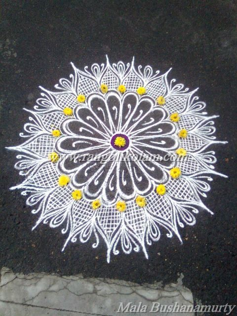 Today thoughts of klolam....... Its better to look ahead and prepare than to look back and despair........ Freehand white design kolam done by Mala Bushanamurty