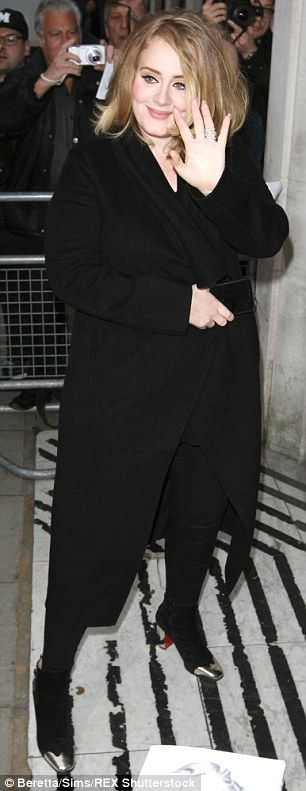 Even the style's the same: Adele stuck to her go-to all black dress code as she slipped on...
