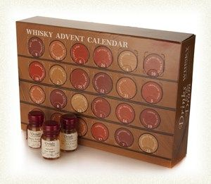 """The Whisky Advent Calendar (2013 Edition)-- First came sliced bread. It was the best thing. Nothing could touch it. Nothing, that is, until Drinks By The Dram created The Whisky Advent Calendar! Now returning for a second outing, it still laughs in the face of chocolate advent calendars. """"Ha!"""""""