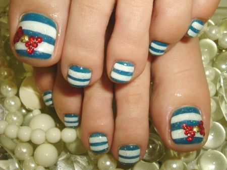 Blue - White - Stripes - Bows - Red - Rhinestones - Gold studs - Toenail design