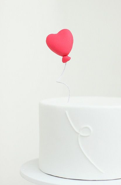 not that I'm getting married, but this would be a great wedding cake top w/the balloon string coming down the tiers.