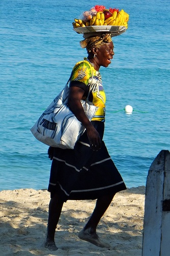 Fruit lady walking on 7 mile beach in Negril...