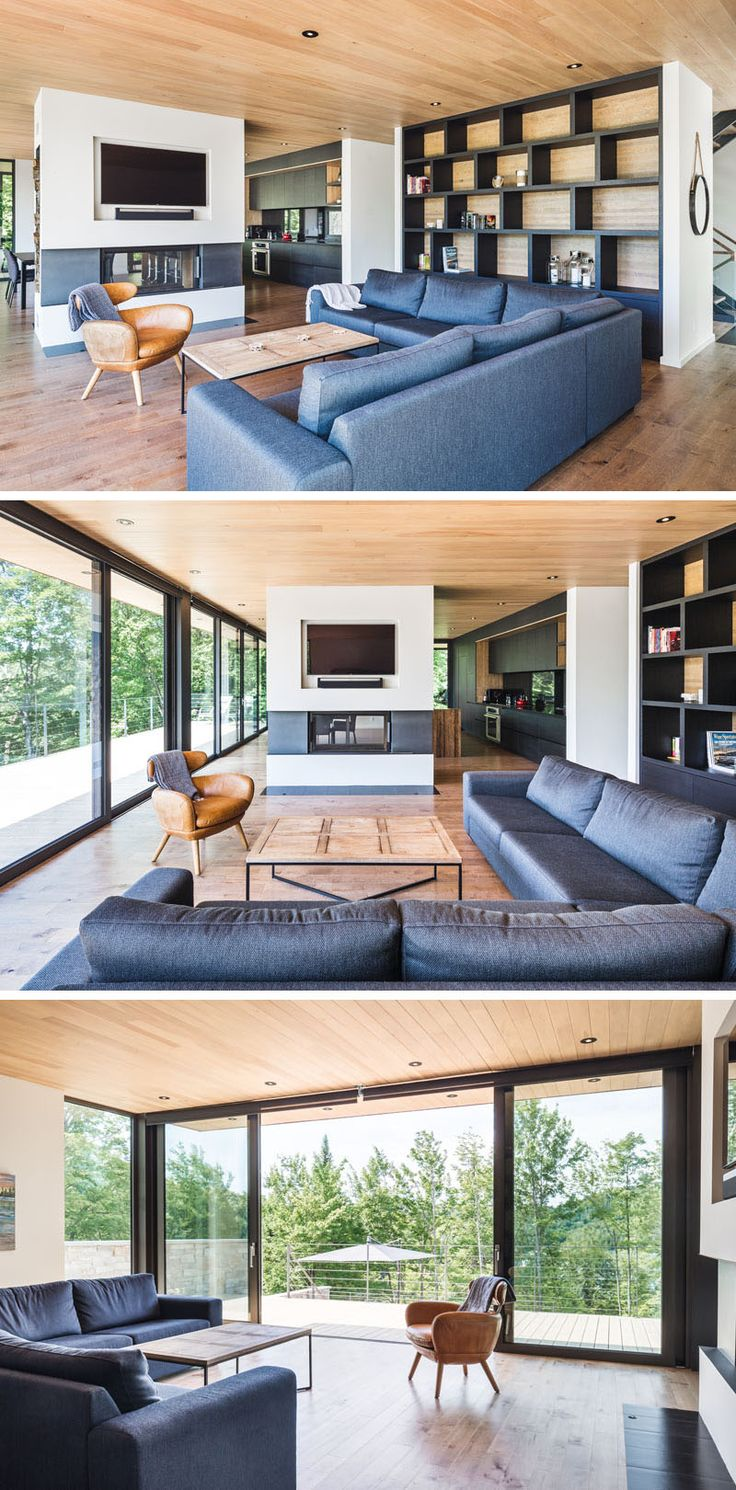 Wood and stone cover the exterior of this multi level modern house in the forest