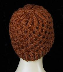 This honeycomb is a simple cable pattern that is great for beginning cable knitters. The post includes a video on how to knit the cable pattern. The honeycomb is an all-over cable pattern of 8 rows.