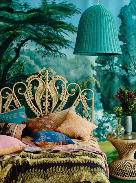 Bohemian and bold wallpaper in this bedroom makes you feel that you were a part of nature