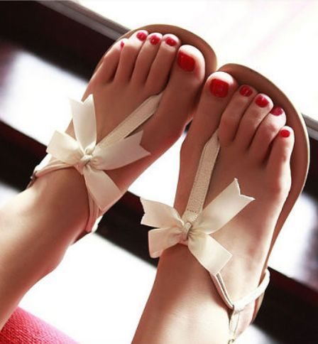 Red Toes in White Leather Sandals