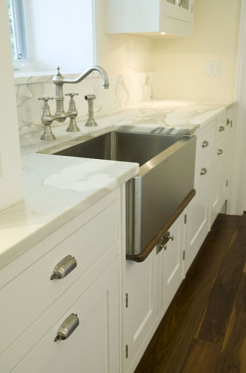 Suzie: Bakes and Company - Beautiful kitchen with pale yellow walls paint color, creamy white ...