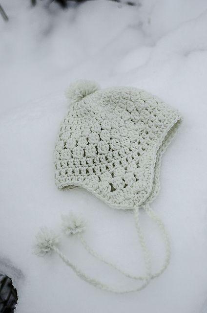 Lovely hat!  Snowbelle Trapper Hat pattern, free pattern by Kalurah